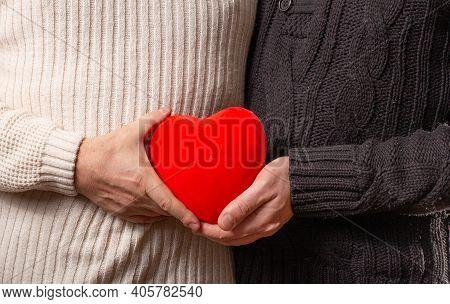 Men Hands Holding Red Heart. Lgbt Concept.