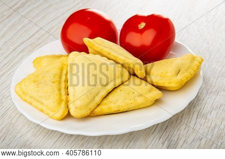 Red Tomatoes, Small Savory Pies In Glass White Plate On Wooden Table
