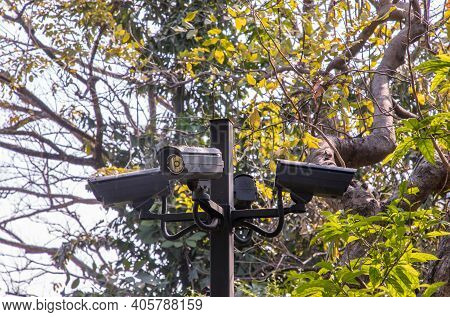 Modern Surveillance Cameras On The Park Background, The Concept Of Surveillance And Visual Inspectio