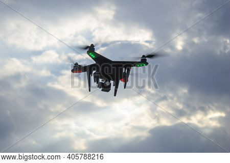 Drone On The Background Of A Blue Cloudy Sky.