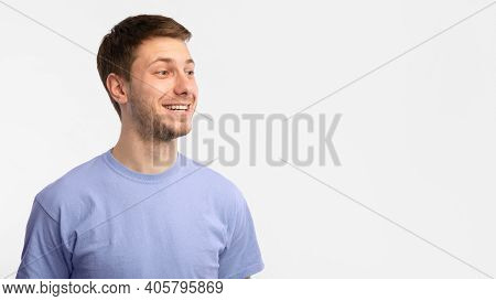 Place For Advert. Headshot Portrait Of Smiling Guy Standing And Looking Away At Copy Space. Young Ma