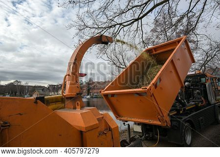Professional Heavy Duty Shredding Machine Blows The Shredded Twigs Into A Dump Truck, During Tree An