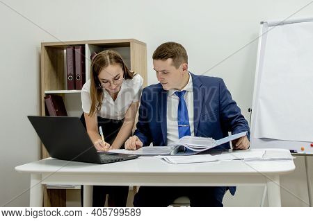 Pretty Female Showing Document To Her Boss In The Office
