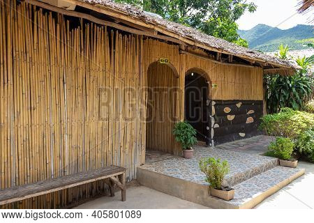 Exterior Of A Public Restroom With Men And Ladies Signs On The Bamboo Wall At Tropical Island