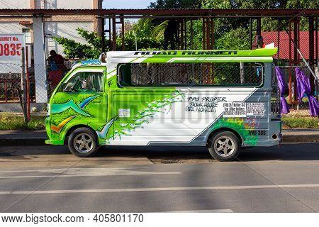 Puerto Princesa, Palawan, Philippines - September 26, 2018: Colorful Public Minibus On City Street A