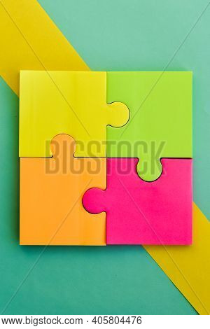 Bright Colorful Stickers For Notes In Form Of Puzzles. Multicolored Square Sheets Of Paper Pasted On