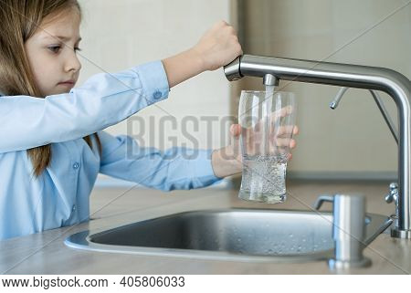 Child Open Water Tap. Kitchen Faucet. Glass Of Clean Water. Pouring Fresh Drink. Hydration. Healthy