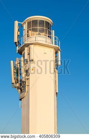 Marino Rocks Lighthouse With Attached Cellular Antennas At Sunset, South Australia