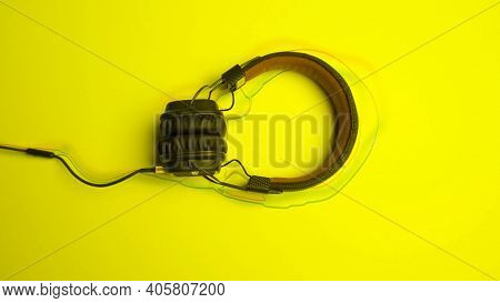 Headphones On Colored Background With Lines. Animation. New Headphones Lie On Colored Background Wit