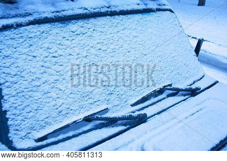 Snow-covered Car Windshield, Hood And Windshield Wiper Brushes