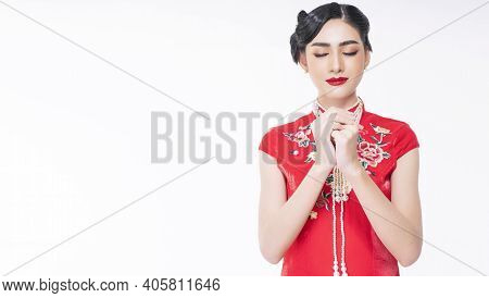 Spring Festival Tradition Chinese New Year Concept. Beautiful Young Woman Wearing  Red Chinese Cheon