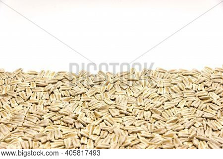Close-up Pile Of Opo Gourd Or Calabash Squash Seeds Isolated On White Background With Copy Space