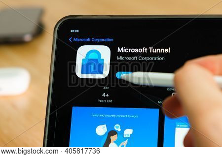 Microsoft Tunnel Logo Shown By Apple Pencil On The Ipad Pro Tablet Screen. Man Using Application On