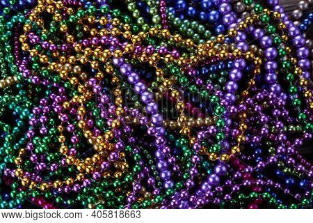 Colorful Mardi Gras Beads Background. Green, Purple And Gold Merdi Gras Beads