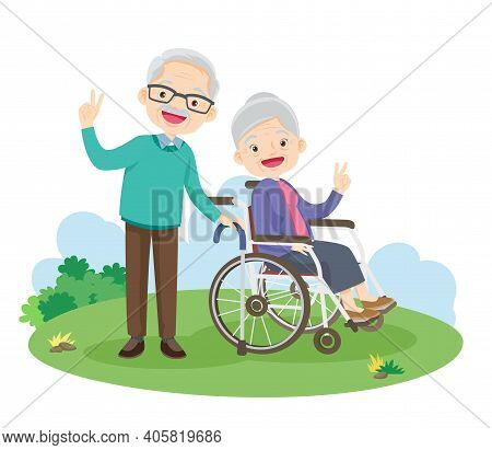 Happy Elderly Gesture Victory Hand Sitting On Wheelchair In The Park. Grandfather And Grandmother So