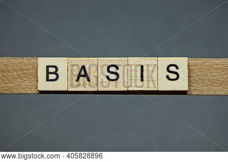 Text The Word Basis From Brown Wooden Small Letters With Black Font On An Gray Table