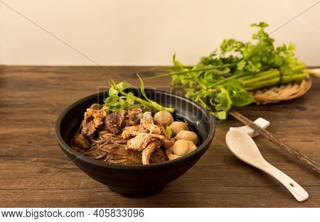Hot And Spicy Nam Tok Noodles Soup With Meat Balls.thai Boat Noodles Is Street Food Of Thailand Styl