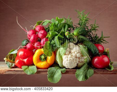 Cauliflower, Tomato, Cucumber, Radish And Paprika With Rosemary Branch.
