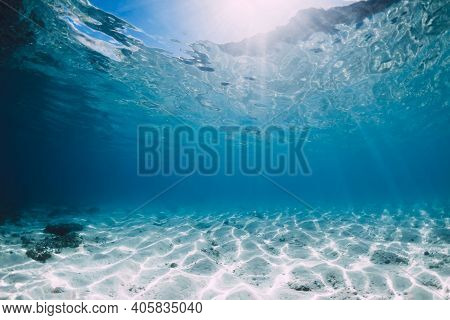 Tropical Blue Ocean With White Sand And Stones Underwater In Hawaii. Ocean Background