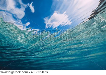Surface Of Blue Ocean With Sky And Sunlight Underwater In Hawaii