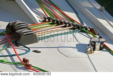 Metallic Pulley Block And Ropes On The Deck Of An Sailboat Ship