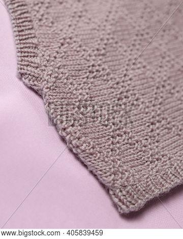 Handmade Merino Wool Vest, Super Yarn, Fashion Concept. Close-up, Merino Wool Background.