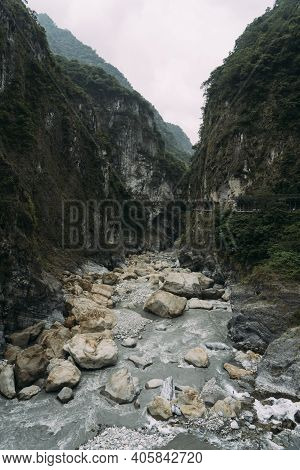 Gray Stony River Bed With Steep Cliffs On Each Side In Taroko National Park In Hualien, Taiwan.