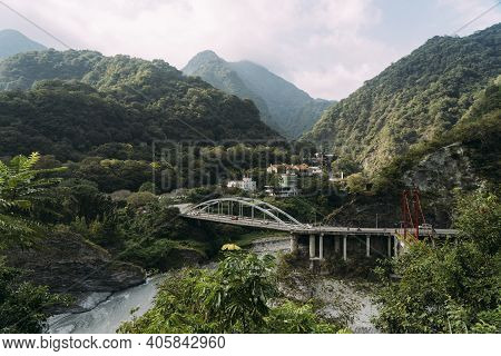 River Valley With Bridge, Small Town And Mountains Behind In Taroko National Park, Hualien Taiwan.