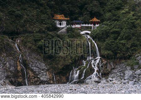 Changchun Shrine With Water Falling Down Rocks In Taroko National Park, Hualien Taiwan.