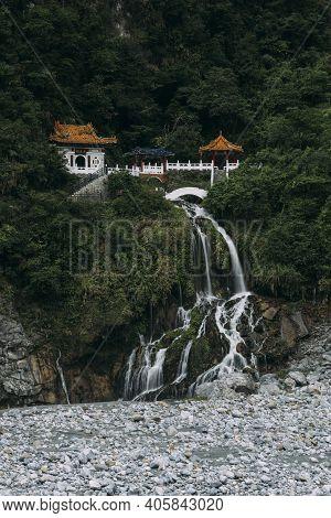 Long Exposure Of Changchun Shrine With Water Falling Down Rocks In Taroko National Park, Hualien Tai