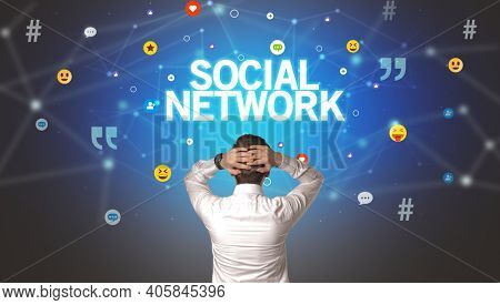 Rear view of a businessman with SOCIAL NETWORK inscription, social networking concept