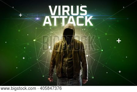 Mysterious hacker with VIRUS ATTACK inscription, online attack concept inscription, online security concept