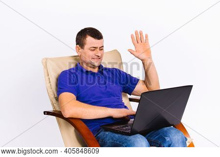 A Man With A Hearing Aid Communicates Non-verbally Via Webcam On Video Online Communication, Senior