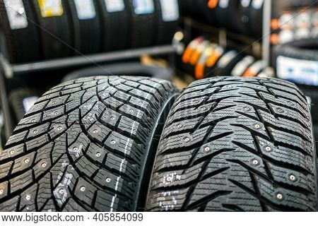 Closeup Of The Tread Of Two Different Studded Winter Tires
