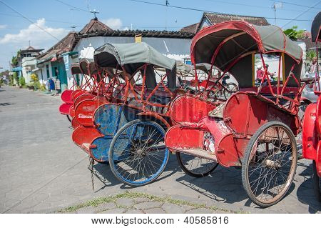 Trishaws In The Street Of Surakarta, Indonesia