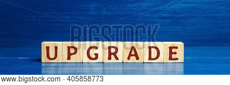 Wooden Blocks With The Word Upgrade. Improvement, Modernization And Renewal Concept. Upgrading Softw