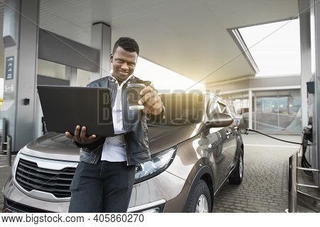 Car Refueling, Business, People Concept. Portrait Of Handsome Young African Man In Black Casual Outf