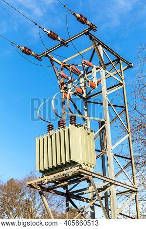 Electricity Pole With Transformer In Czech Republic. The Transformer Box On Electric Pole Against Th