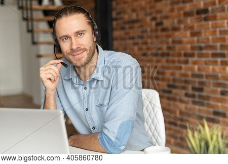 Millennial Young Male Salesman In A Headset Is Holding The Microphone, Hipster Customer Service Repr