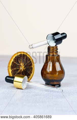 The Concept Of Environmentally Friendly Cosmetics And Aromatherapy. Bottle For Essential Oils And Co
