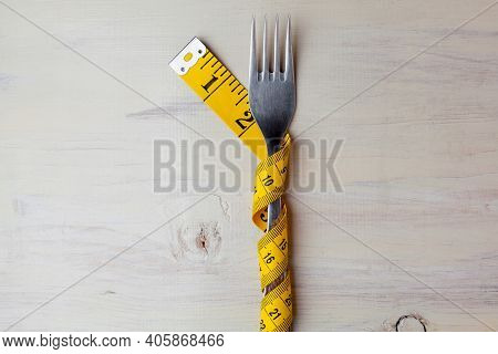 Diet, Light Wooden Background, Fork Wrapped In A Meter, Fork On White Background, Diet, Meter, Healt