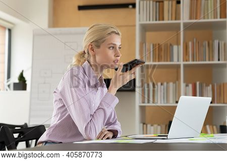 Female Millennial Employee Recording Audio Message On Smartphone