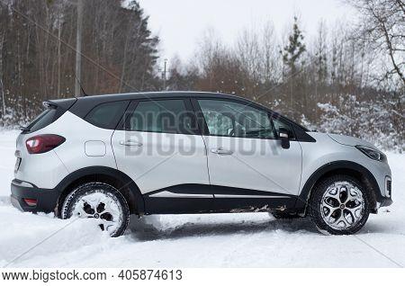 Grodno, Belarus-01.31.2021: Side View Of A Renault Capture Or Renault Captur Suv On A Winter Road Ag