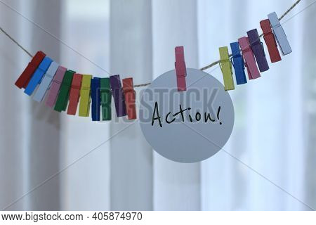 Handwriting Single Word - Action. Inspirational Motivational Notes On Tag Label Paper Hanging On Rop