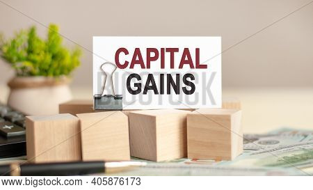 Motivational Words: Capital Gains. Piece Of Paper With The Text: Capital Gains. Business And Finance