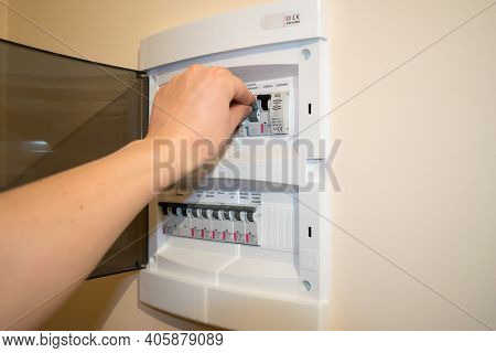The Fuse Box Is Open, A Man's Hand Turns Off The Fuse