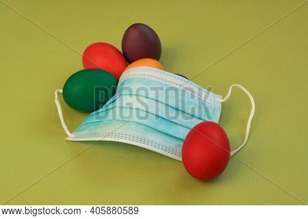 Isolated Colored Painted Easter Eggs And Medical Mask, A Symbol Of Coronavirus Pandemic. Safety Firs