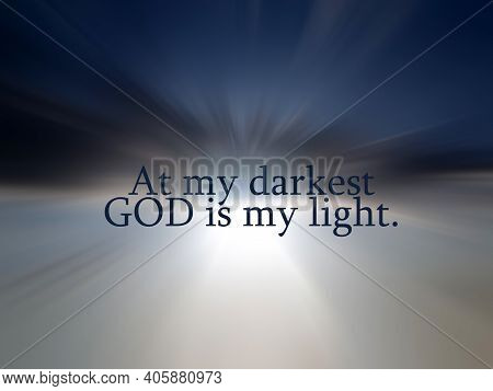 Spiritual Inspirational Words - At My Darkest, God Is My Light. Believe In God Concept With Quote On