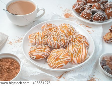 Lemon Cookies And Small Eclair Cakes On A White Background. Top View, Horizontal.