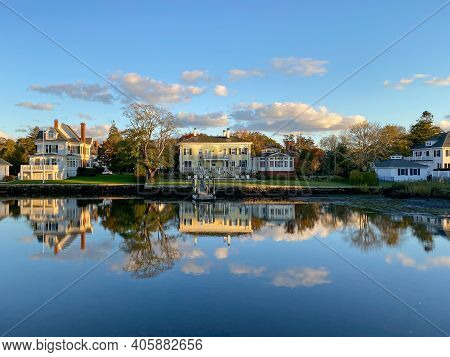 Sunset Along The Mystic River In Mystic, Connecticut As Reflections Float Above The Still Water.